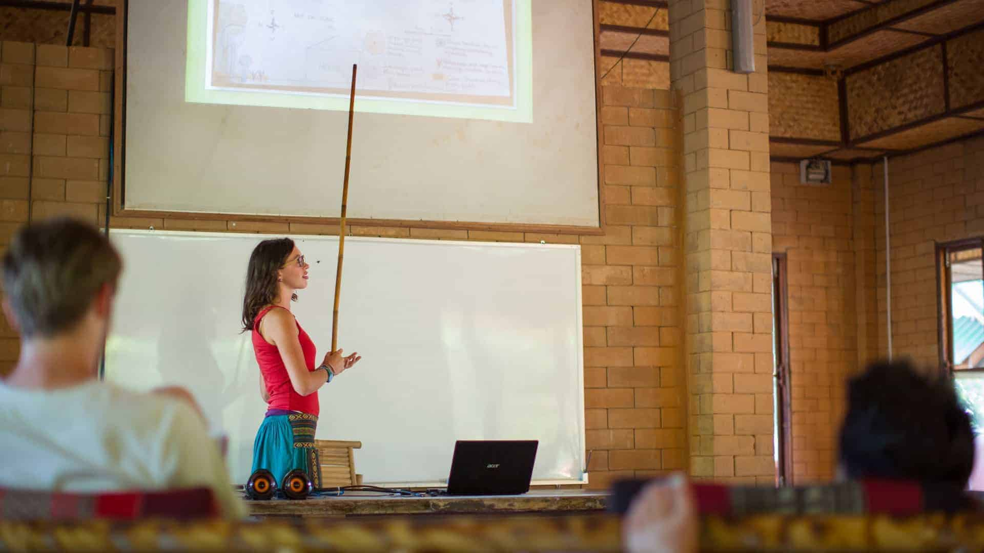 Permaculture student Master Plan presentation in the classroom