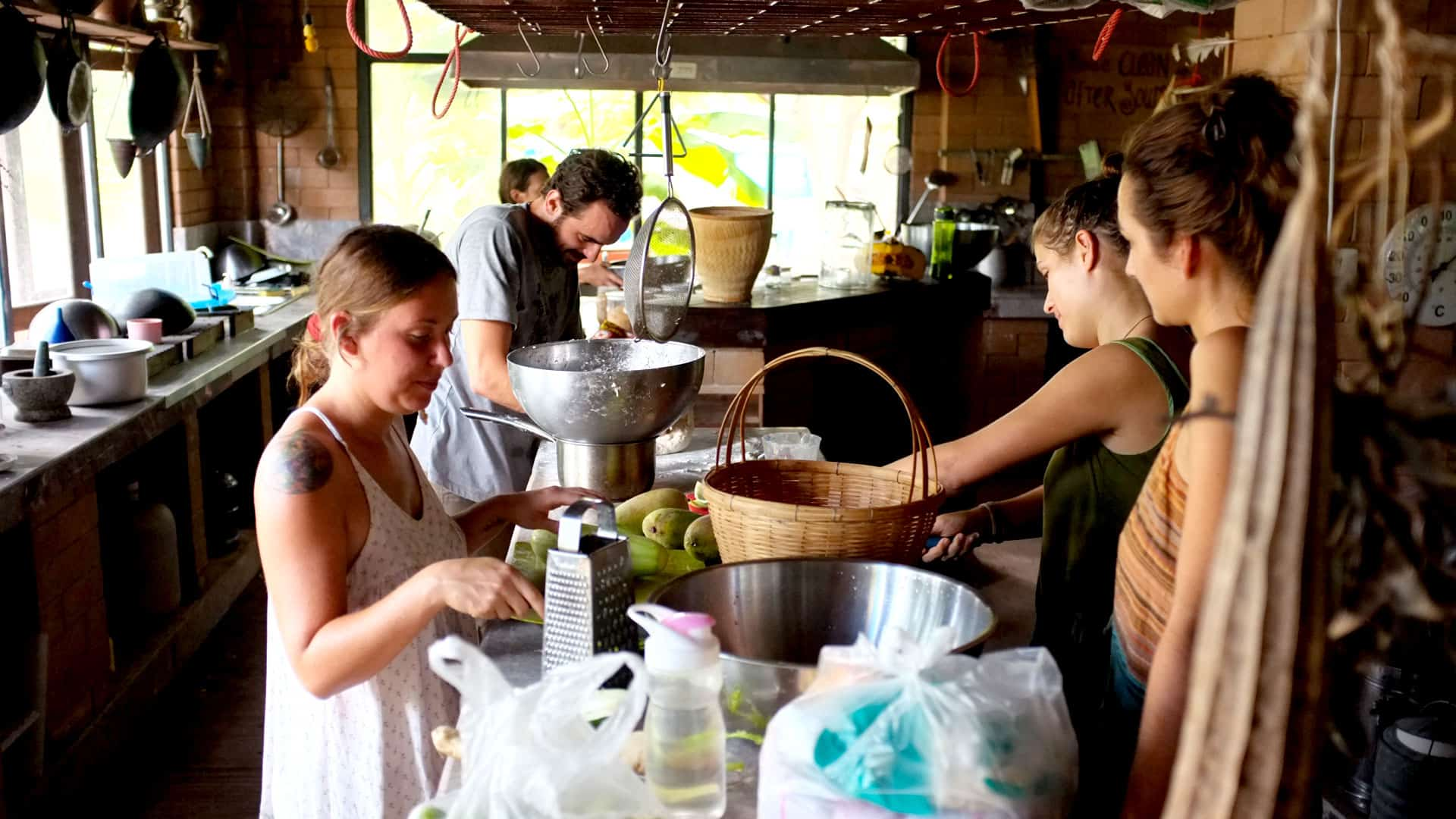 Permaculture students preparing food in the communal kitchen