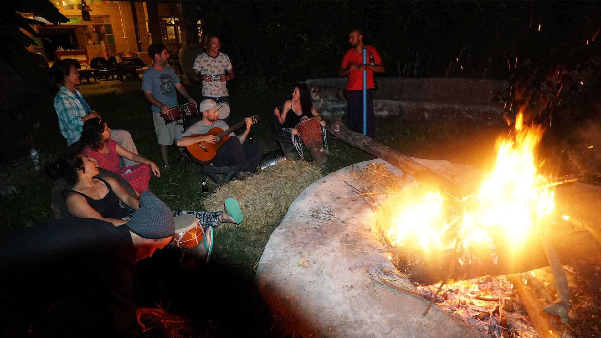 Image of permaculture students next to the fire pit