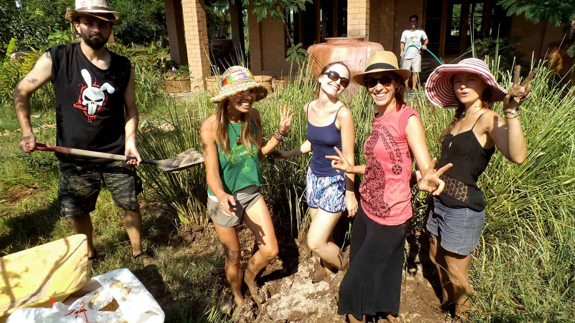 Image of students in the natural building mudpit