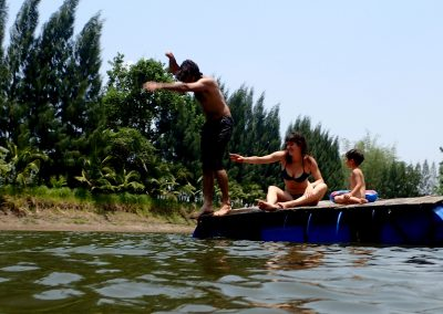 Student diving in the pond at Rak Tamachat Permaculture Thailand