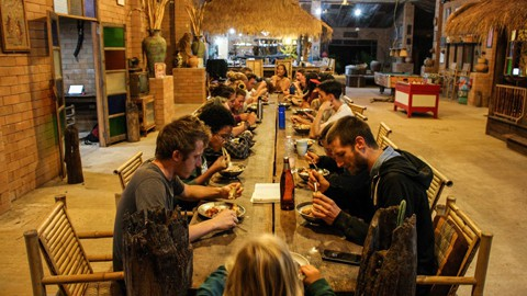 Diner at the communal table at Rak Tamachat Permaculture Thailand
