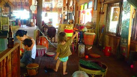 Children having fun in the music lounge at Rak Tamachat Permaculture Thailand